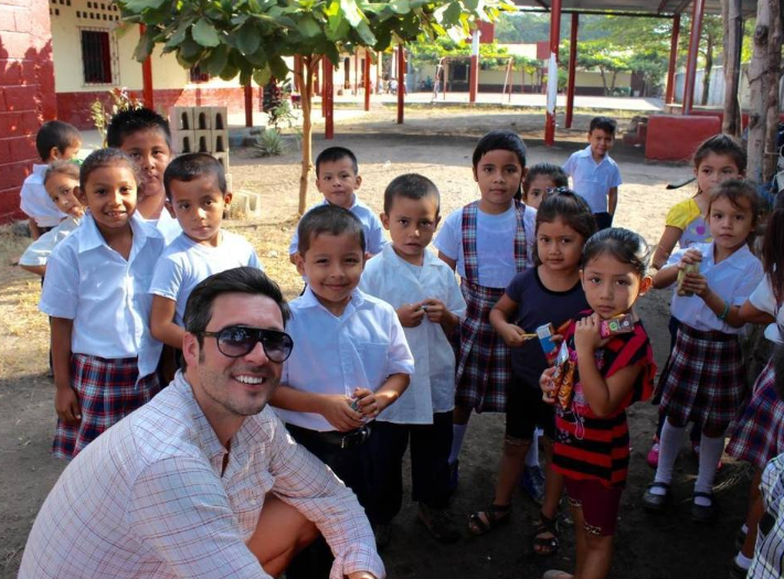 dr bart roach with children in guatemala